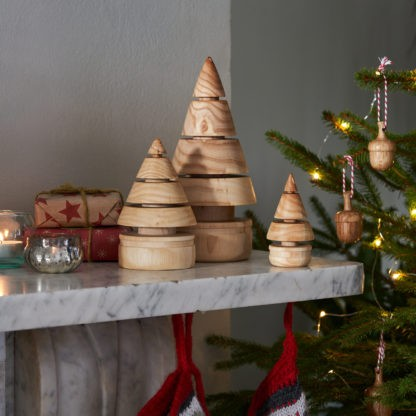 wooden christmas tree set on a mantlepiece