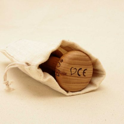 wooden rattle in cotton gift bag