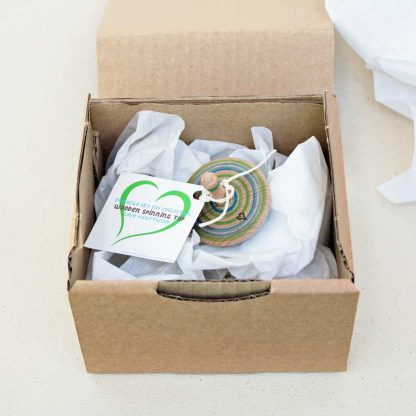 spinning top in plastic free packaging