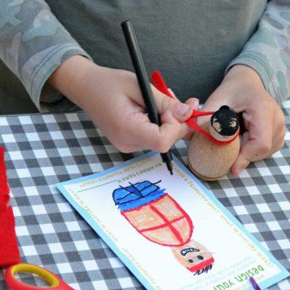 boy making a peg doll