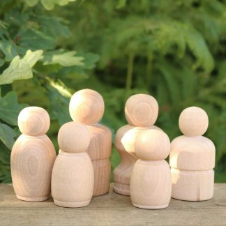 wooden peg doll family outdoors