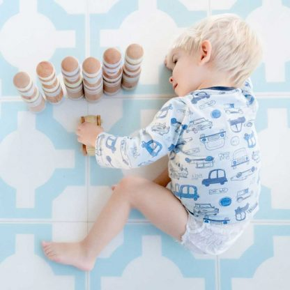 blue toddler plays with wooden toys