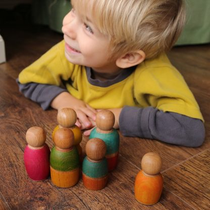 boy with wooden peg dolls