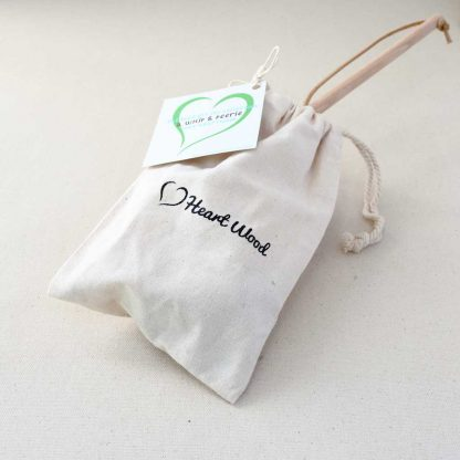 whip and peerie in a cotton bag