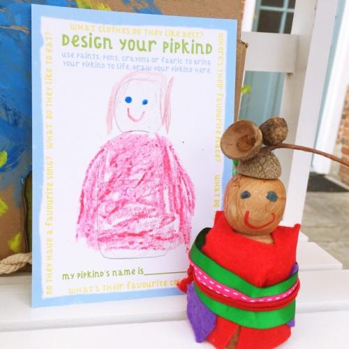 wooden peg doll with acorn cap hat
