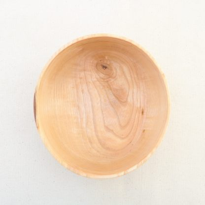 top view of a handmade oval wood bowl