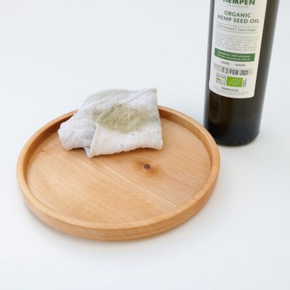 oiling a wooden plate with hemp oil