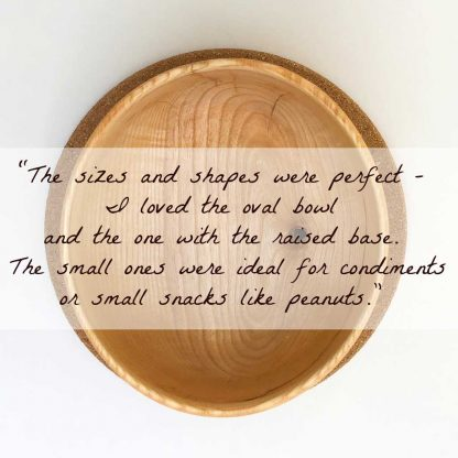top view of an oval wooden bowl with a testimonial