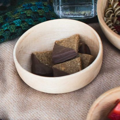 wooden bowl with vegan chocolate flapjacks