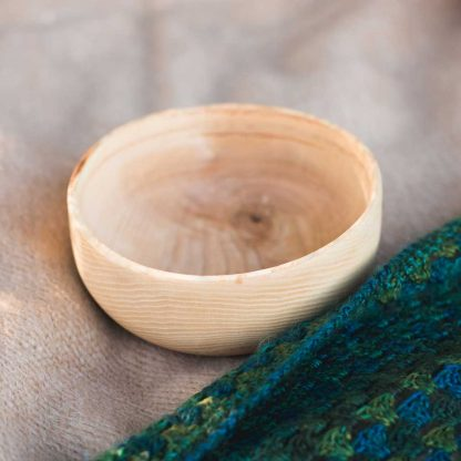 oval wooden picnic bowl on a blanket