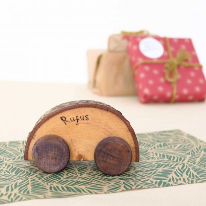 personalised wooden car with coloured wheels