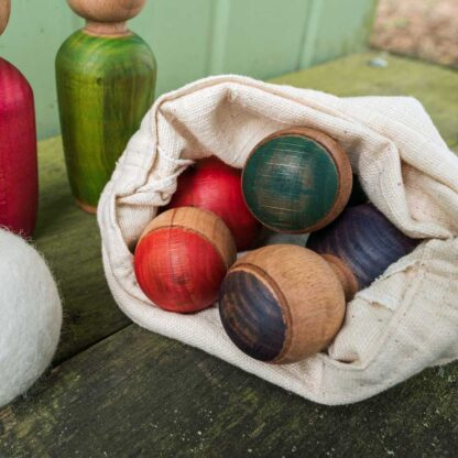wooden skittles in a bag